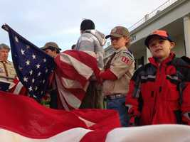 A local Boy Scout troop puts up flags at Mount Vernon Memorial Park on Memorial Day. (May 27, 2013)