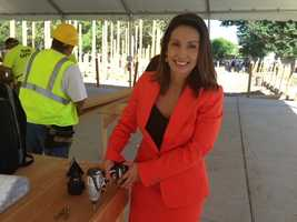 KCRA 3's Leticia Ordaz holds a drill near the park's construction area.