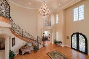 The home has this grand ballroom entrance.