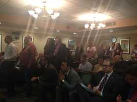 A line of people wait to testify inside the Capitol regarding a possible audit of CPS.