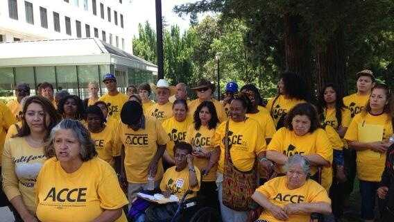 A community group from Los Angeles demonstrates against Sen. Ron Calderon, saying he has received gifts in excess.