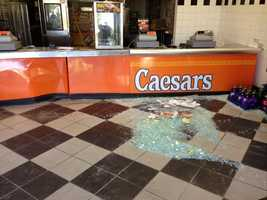 Surveillance video shows a pickup truck repeatedly slamming into a pizza shop in the Natomas area of Sacramento before taking off with a safe.