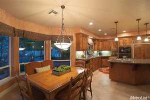 Check out this dining area and kitchen with granite counters and a butler's pantry.