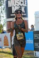 """12. I love to compete in fun races, and this was my first """"Muddy Buddy"""" race. Running, biking, going through obstacles and crawling through a huge mud pit. It was awesome!"""