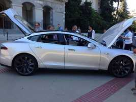 Telsa Motors showed off some of its higher-end models at the State capitol Tuesday and said it hopes to manufacture 20,000 of its electric vehicles within the state.