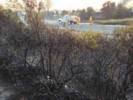 A fast-moving grass fire in Fairfield spread to the nearby Motel 6 on Tuesday evening, fire officials said (June 18, 2013).