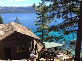 Bruce Ells, a Lake Tahoe real estate broker, walks outside an estate that once belonged to Howard Hughes, a philanthropist from the early 1900s (June 26, 2013).
