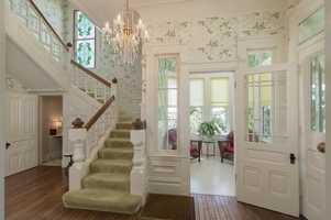 The foyer opens to the home's conservatory.