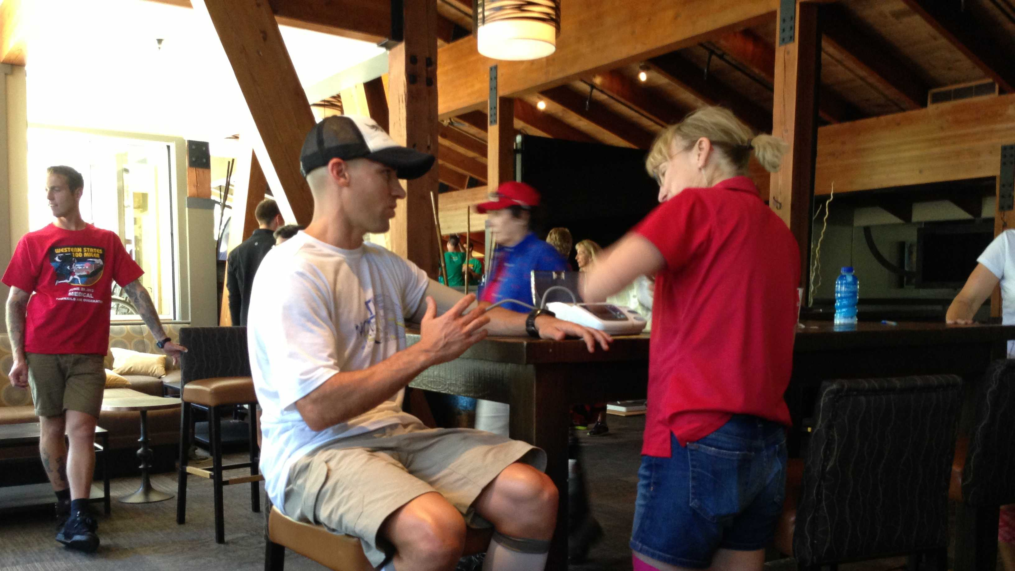A runner's blood pressure is checked ahead of this weekend's Western State's 100-mile Endurance Run.