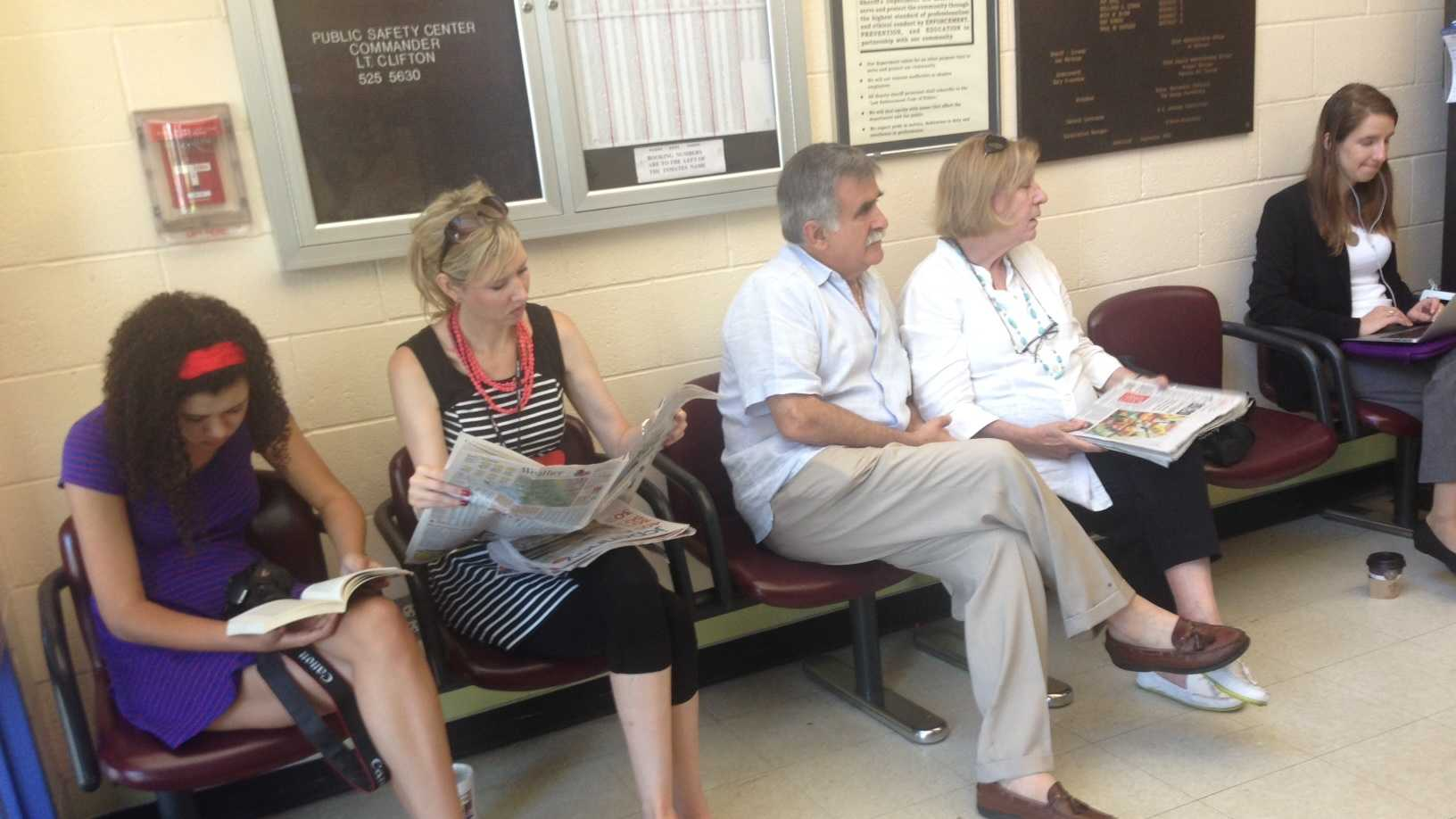 George Souliotes' family wait in the lobby for his release Wednesday.