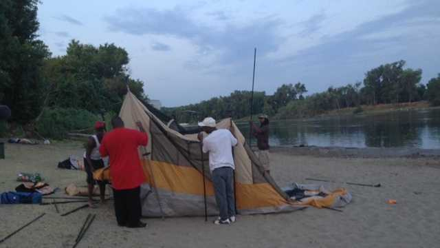 Fourth of July festivities began before sunrise with a rush for prime spots along the American River Thursday morning.