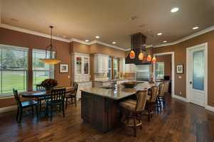 But first, take a look at this gourmet kitchen with dinette. The room opens to a spacious family room.