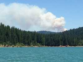 Caltrans shut down a stretch of Highway 50 in the Sierra after a grass fire broke out in rural El Dorado County.