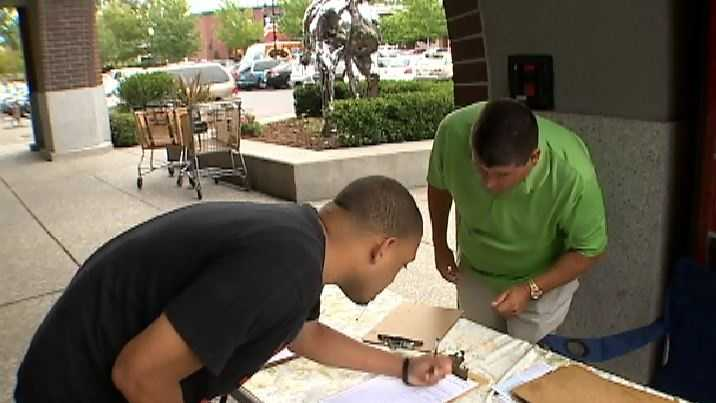 Arena subsidy opponents collect petition signatures on June 26 in Sacramento.