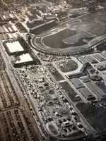 This aerial view of the California State Fair grounds at Stockton Boulevard, where the Fair was located before it moved to Cal Expo, was taken in the 1930s and features the Horse Show Arena.