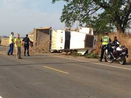 Two drivers were injured along Sunrise Boulevard in a head-on crash that caused a truck hauling 50,000 pounds of sand to topple over in Rancho Cordova.