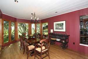 The dining room has plenty of light and viewing of the surrounding oaks, cedars and redwoods.