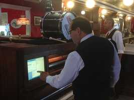 Farrell's president Michael Fleming picked out tunes on a piano player.