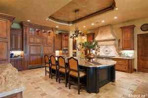 The kitchen has granite counter-tops and a pantry closet.