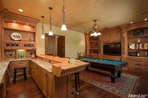 Another room acts as a game room with a full bar.
