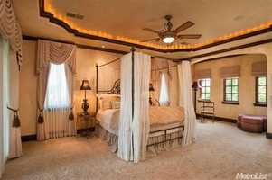 The master suite includes a fireplace.