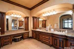 The master on-suite has a vanity and separate his and her sinks.