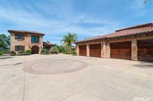 The Loomis home includes a four-car attached garage and a separate detached RV garage.