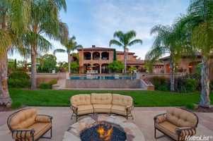 Beyond the huge pool is an outdoor fireplace.