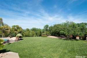 The Mediterranean home is situated on five finely-manicured acres.