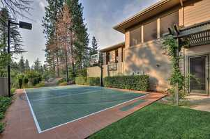 And to top it off, this home has this basketball court and overhead light. For more information on this home, go here.