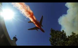 A firefighting DC-10 swoops in over homes near the town of Groveland.