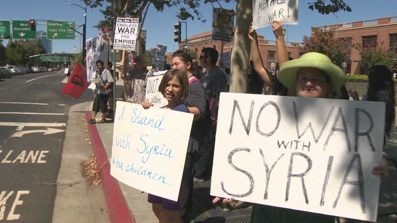 Dozens of protesters lined the street in front of the federal courthouse in Downtown Sacramento to voice opposition to military intervention in Syria.