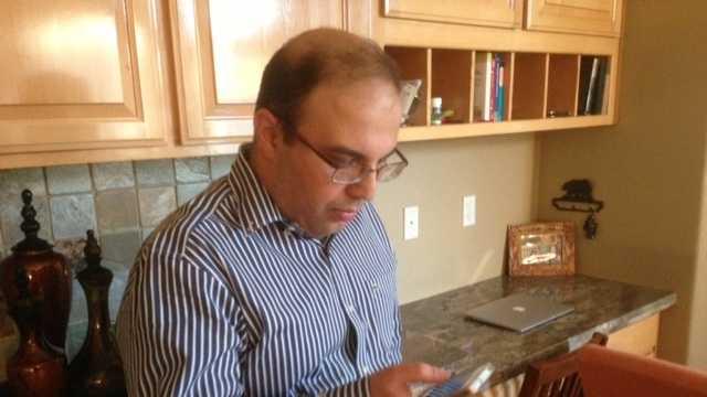 Syrian-American checks cellphone