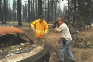 "22. This was one of the times I was nearly speechless while reporting. This was dubbed ""the street devastation"" after the South Lake Tahoe wildfire in 2007. Here I am with Chief Photographer Mike Rhinehart."