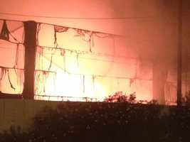 Flames from a recycling plant fire in Stockton leaped 30-feet into the sky and threatened high-voltage power lines that run parallel with the facility on Filbert Street.