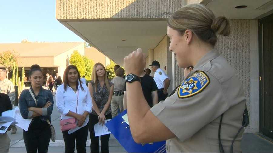 An officer speaks to potential recruits at the CHP academy in West Sacramento.