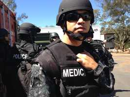 Dressed in bullet proof armor, a Roseville paramedic prepares to train with the SWAT team.