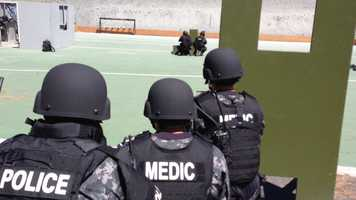 The medics are trained to move with the SWAT team even while a shooter may still be firing at them.