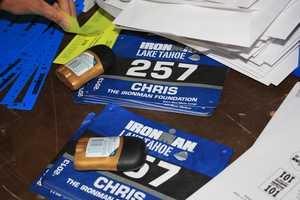 Organizers assemble race-day gear.