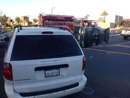 A vehicle flipped over in a two-vehicle crash in front of a middle school in Elk Grove Friday morning.