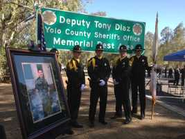 """Assemblywoman Mariko Yamada and Yolo County Sheriff Ed Prieto dedicated the Interstate 5 rest area, """"Deputy Tony Diaz, Yolo County Sheriff's Office, Memorial Rest Area,"""" with Diaz's family in attendance."""