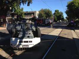 A Jeep traveling along a downtown Sacramento street rolled over in a crash Monday morning.