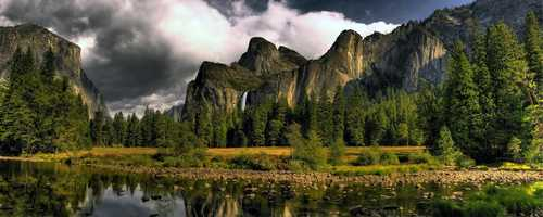 The Yosemite Valley is located in California's Sierra Nevada mountain range and was once home to Native American people. Yosemite saw a boom in visitors in 1849 during the gold rush era.