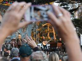 A fan snaps of a photo of Bonnie Raitt at Hardly Strictly Bluegrass in San Francisco's Golden Gate Park on Friday, Oct. 4.