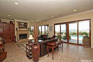 From within the living room and its large windows, enjoy these amazing views of the vineyard outside the home.
