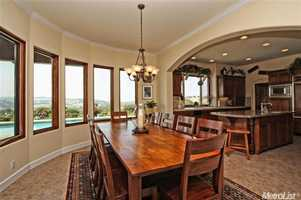 The views inside this home never end -- check out the dining area and the sights it provides.