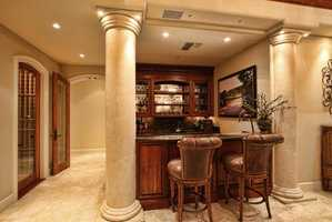 Need a drink after a long day at work? A wet bar inside the home will delight you.