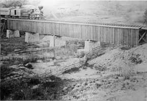In this 1865 photo, a locomotive leaves Roseville for Sacramento over Dry Creek near Sixth Street.