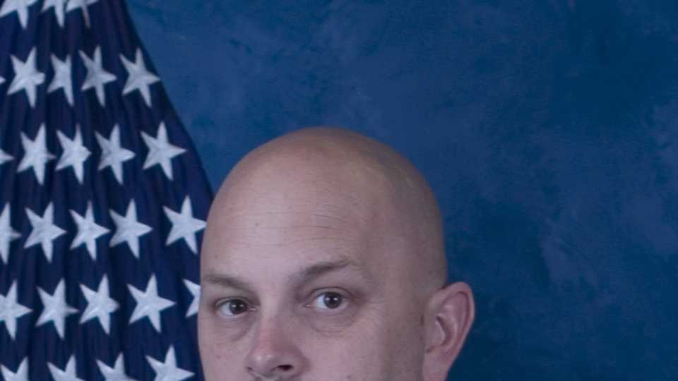 Authorities say Michael Landsberry was a middle school math teacher and a member of the Nevada Air National Guard.