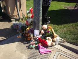 Candles, flowers and toys are among the items left.